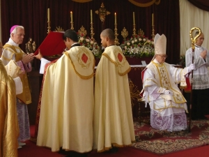 Episcopal_consecration_of_Fr_Faure_sitting_by_Bp_Williamson_2015